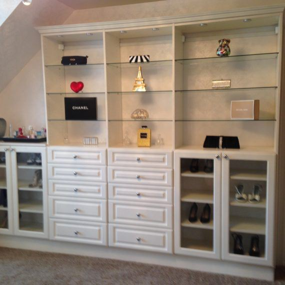 white shelves and drawers