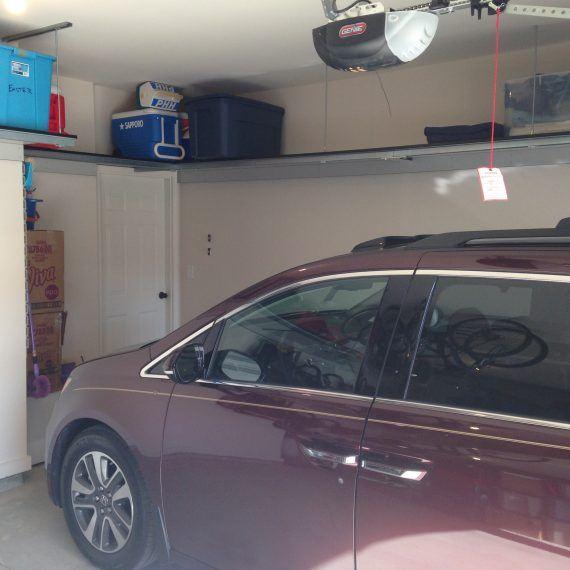maroon van parked in a garage